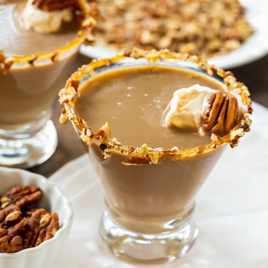 Martini in a glass with chopped pecans around rim.