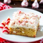 Blondie on a small white plate with peppermint kisses.