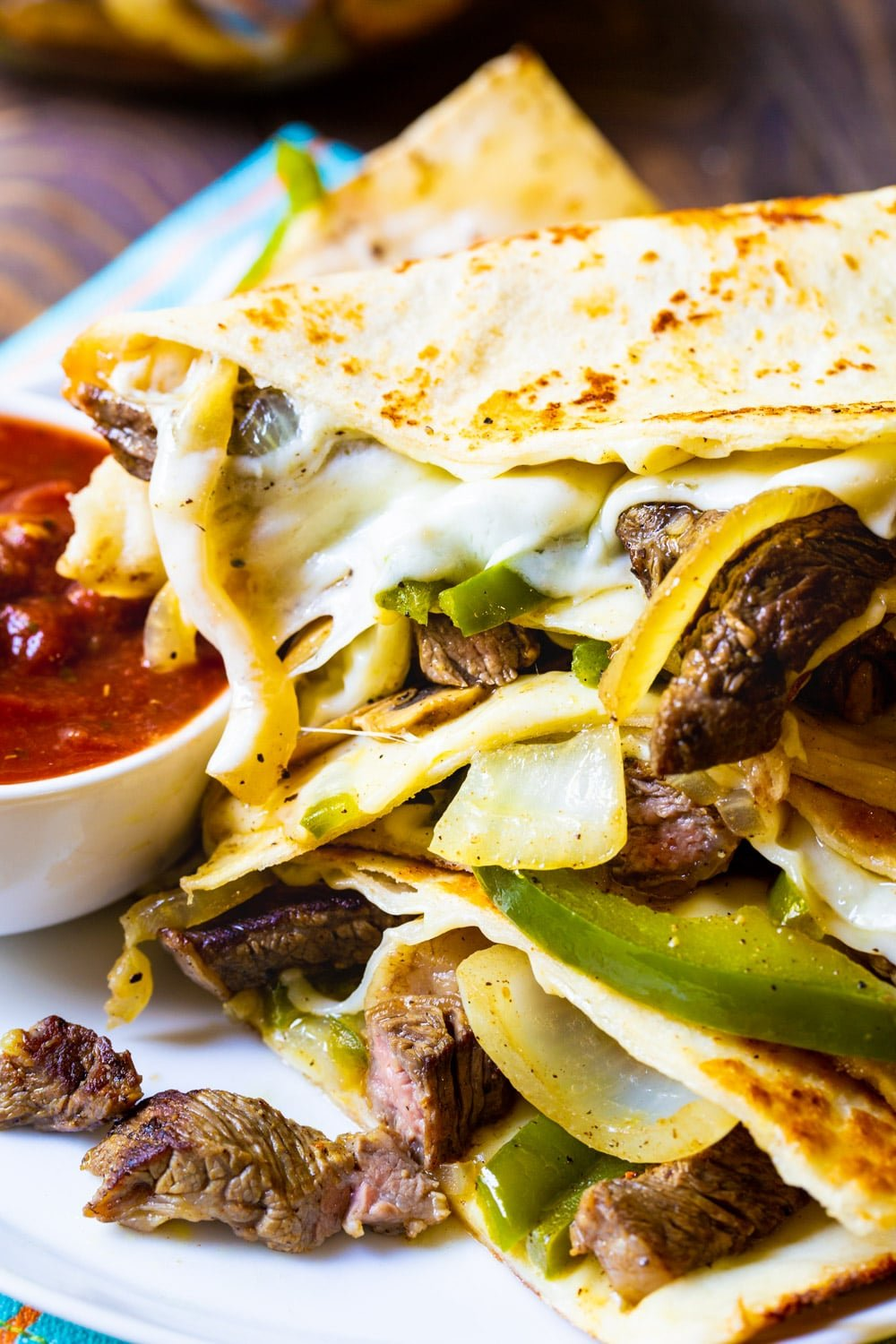 Philly Cheese Steak Quesadillas on a plate with salsa.