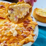 Baked Pimento Cheese Dip on a piece of toasted baguette.