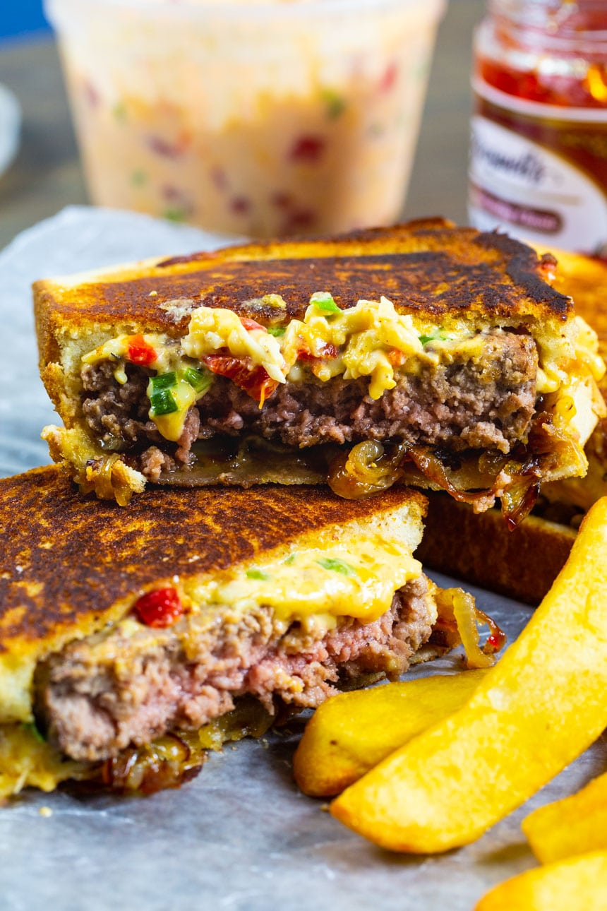 Pimento Cheese Patty Melt cut in half with fries.