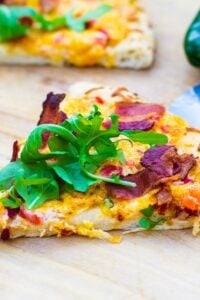Slice of Pimento Cheese Pizza topped with Arugula