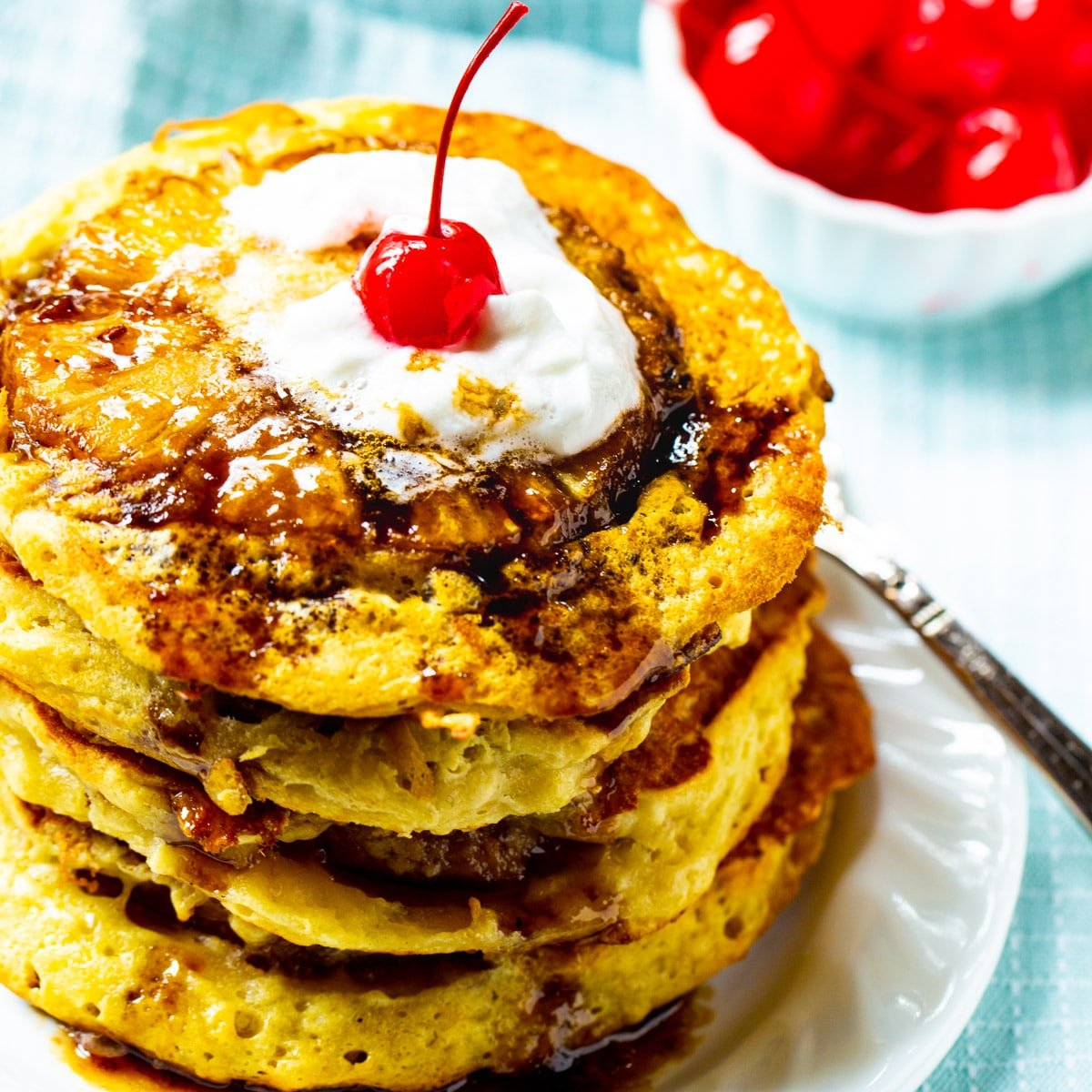 Stack of Pineapple Upside Down Pancakes on a plate.