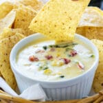 Poblano and Corn Queso with tortilla chips.