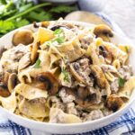 Ground Beef Stroganoff with egg noodles in a white bowl