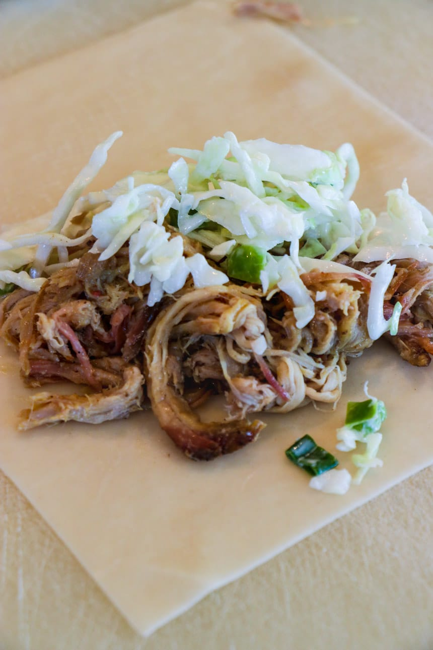 Pulled pork and coleslaw on egg roll wrapper.