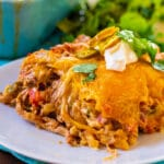 Slice of Pulled Pork King Ranch Casserole on a plate.