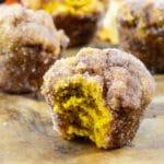 Pumpkin Doughnut Muffins with a bite taken out.
