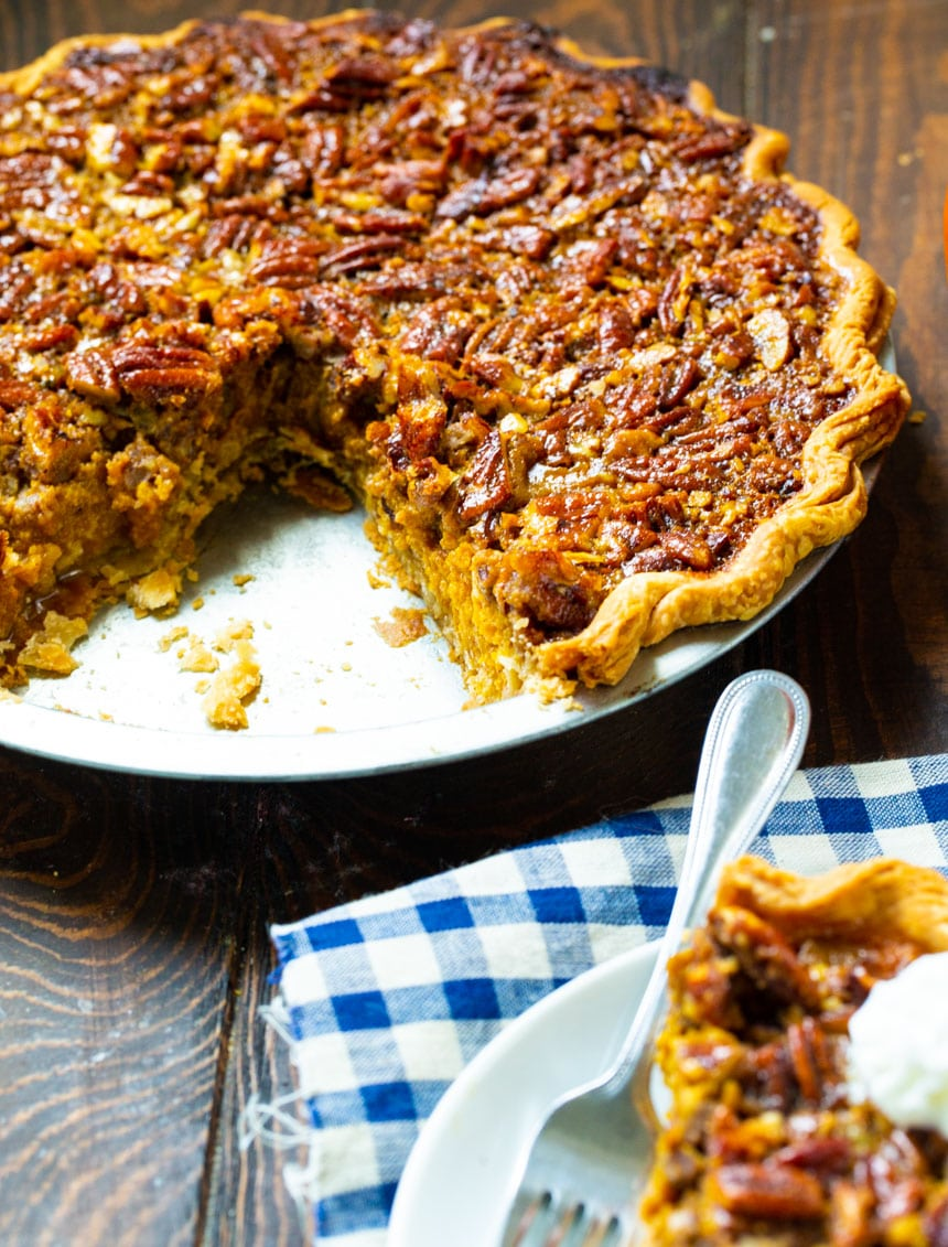 Pumpkin Pecan Pie with a slice cut out.