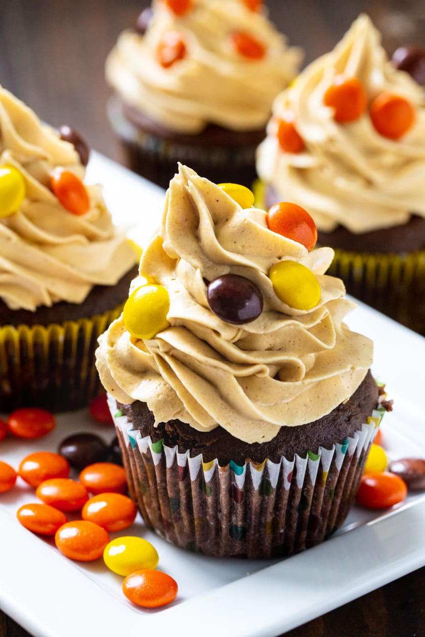 Cupcakes on a plate with Reese's Pieces.