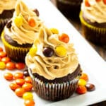 Chocolate Reese's Cupcakes topped with peanut butter frosting on a serving platter.
