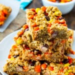 Reese's Pieces Oatmeal Bars stacked on a plate.