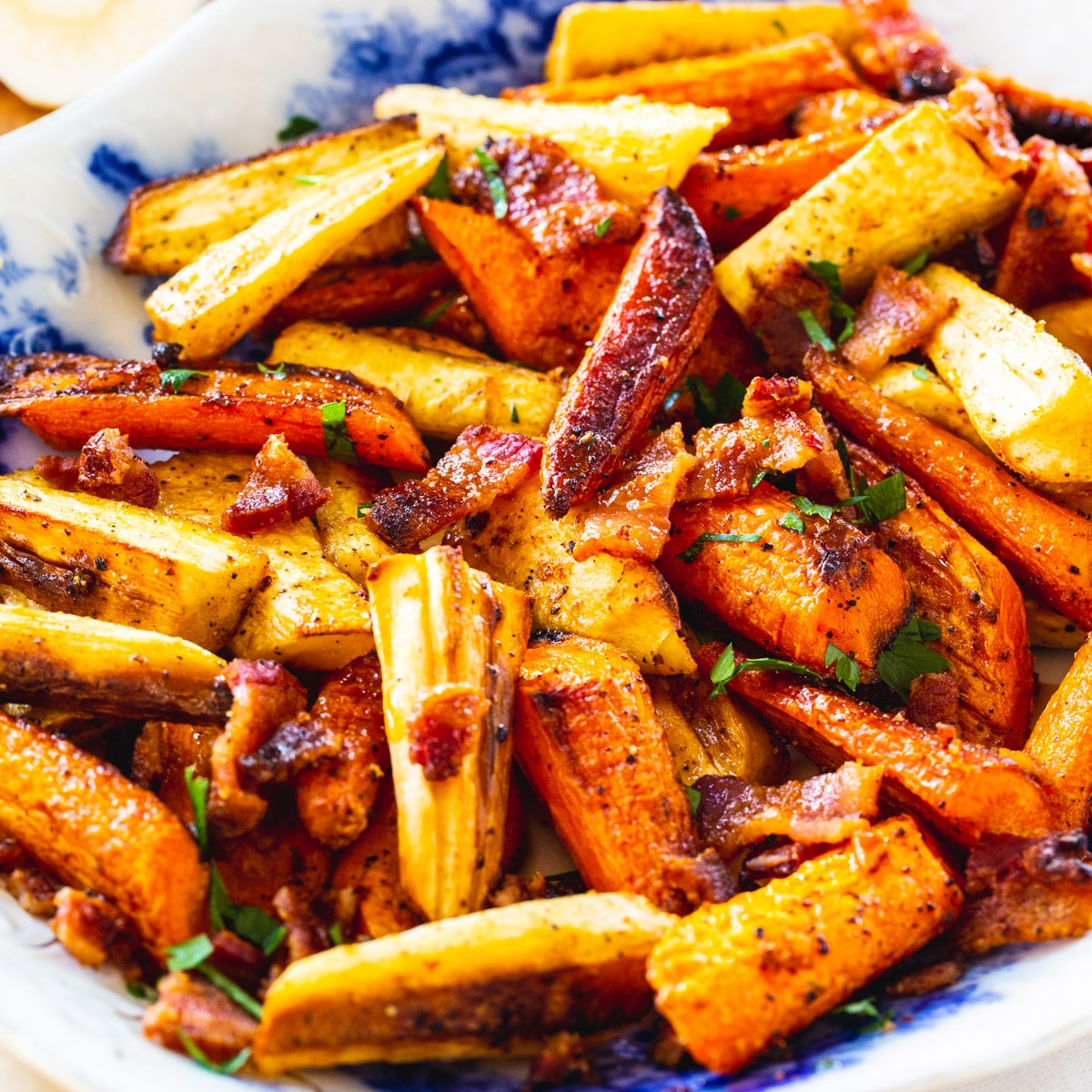 Roasted Carrots and Parsnips on a blue and white serving platter.