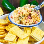 Roasted Jalapeno Pimento Cheese in a bowl surrounded by crackers.