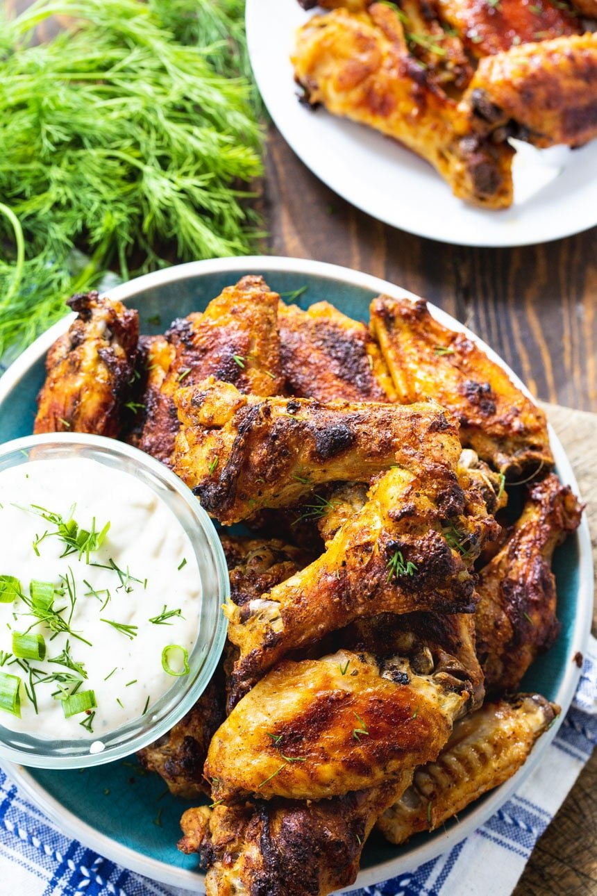 Ranch Wings on a plate with bowl of Ranch dressing.