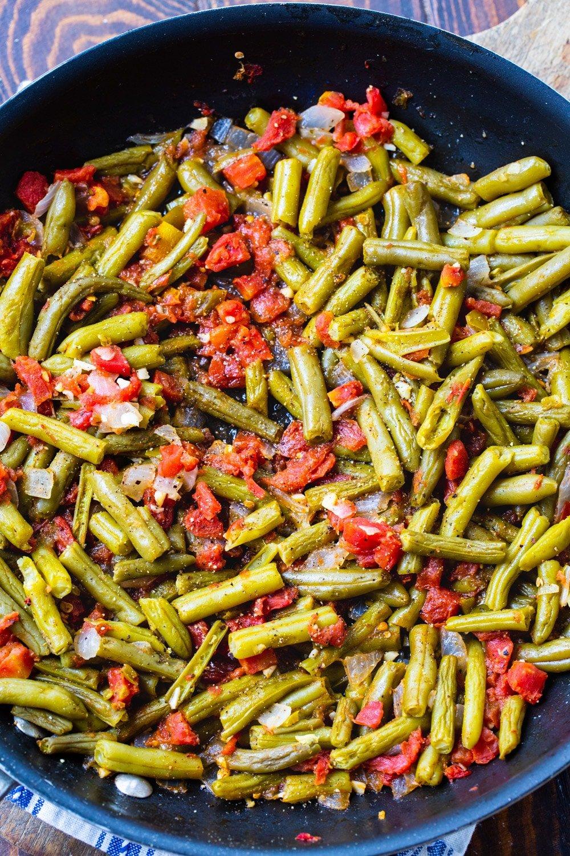 Finshed green beans in a nonstick skillet.