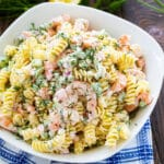 Shrimp and Dill Pasta Salad in a white serving bowl.