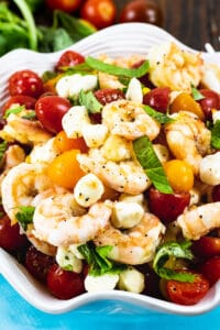 Marinated Shrimp, Tomato, and Mozzarella Salad in white serving bowl.