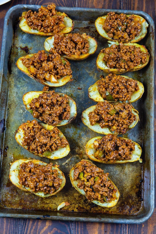Potato halves filled with sloppy joe mixture.