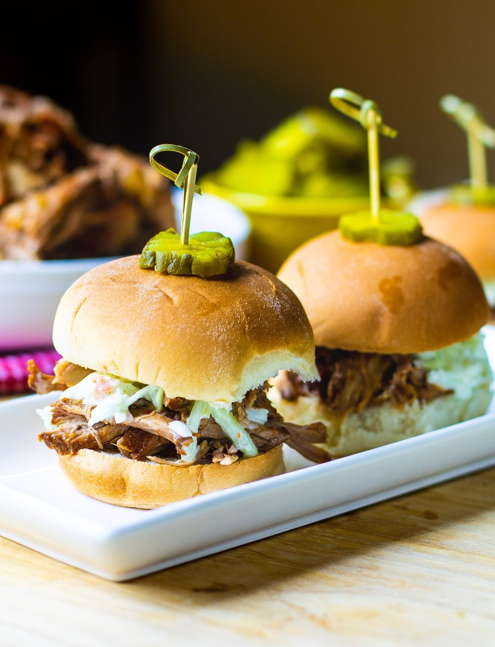 Carolina-Style Pulled Pork on slider buns with coleslaw.