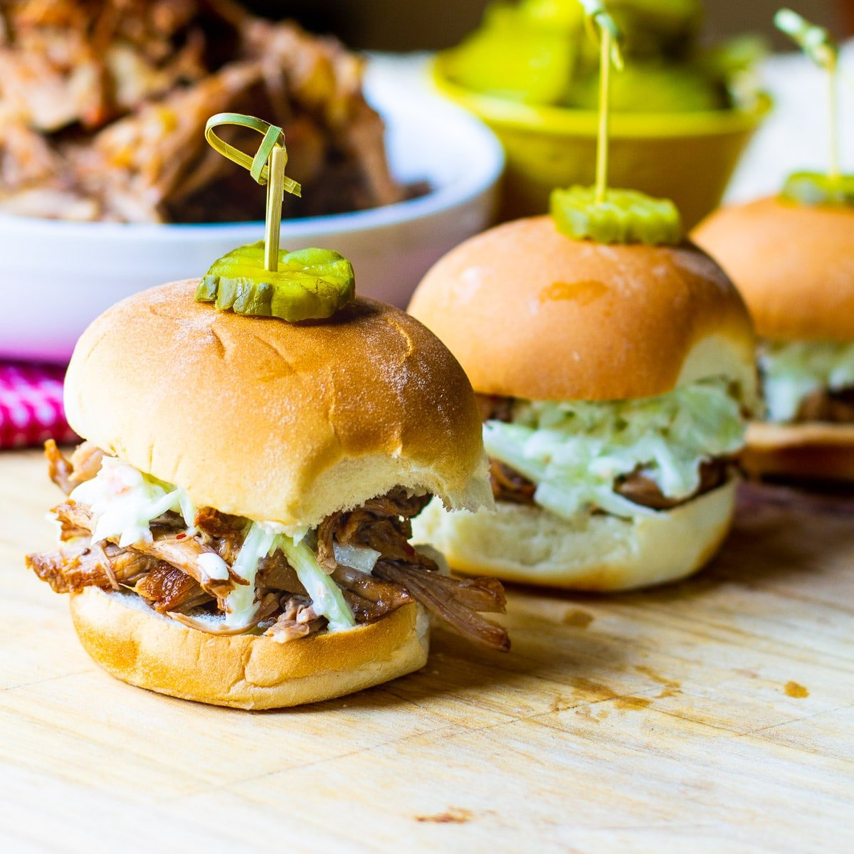 Slow Cooker Carolina-Style Pulled Pork on slider buns with slaw.