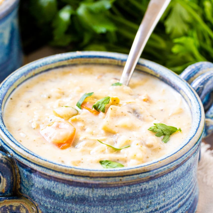 Creamy Chicken Soup in a blue bowl.