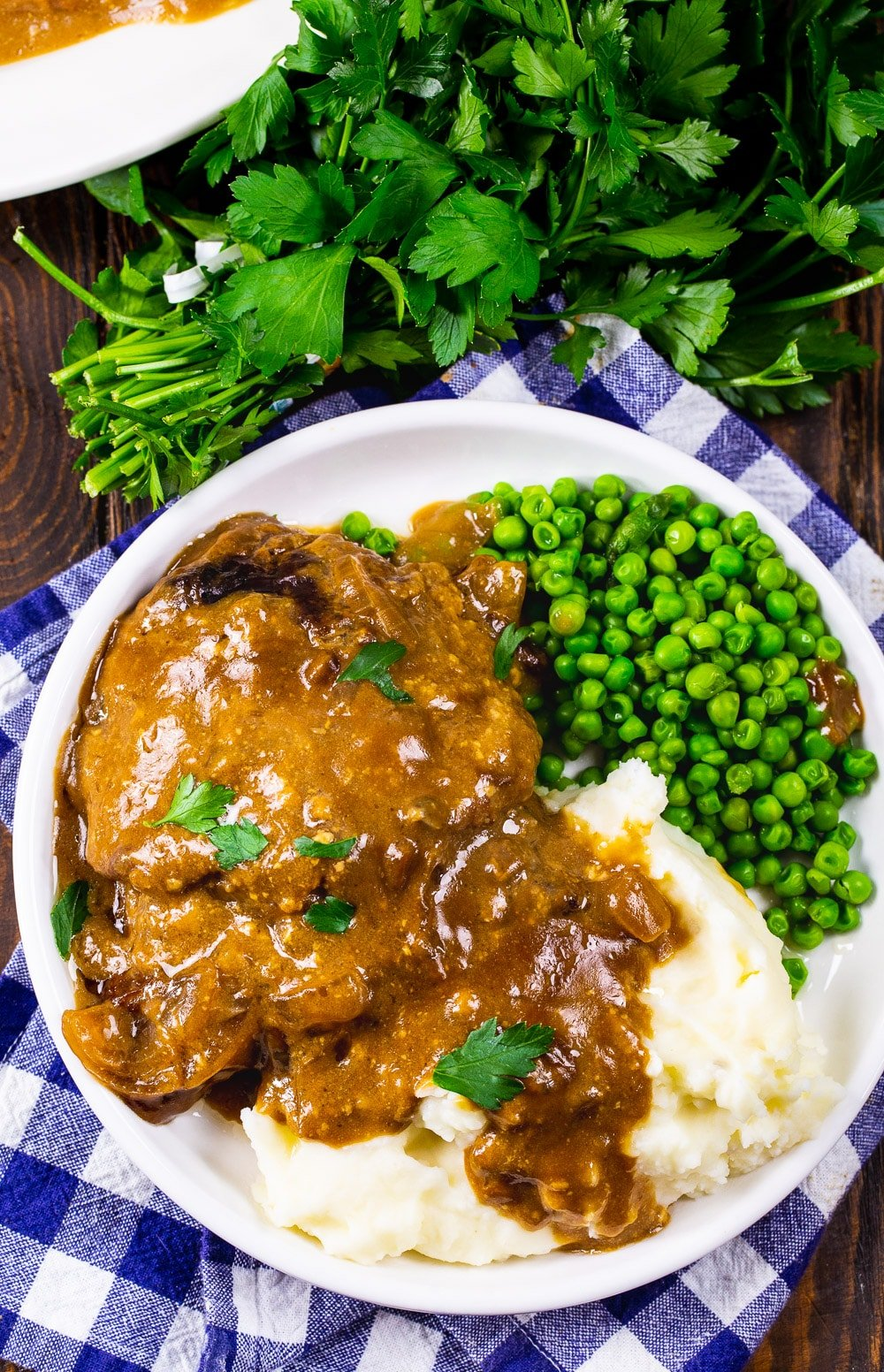 Cubed Steak with Gravy on a white plate.