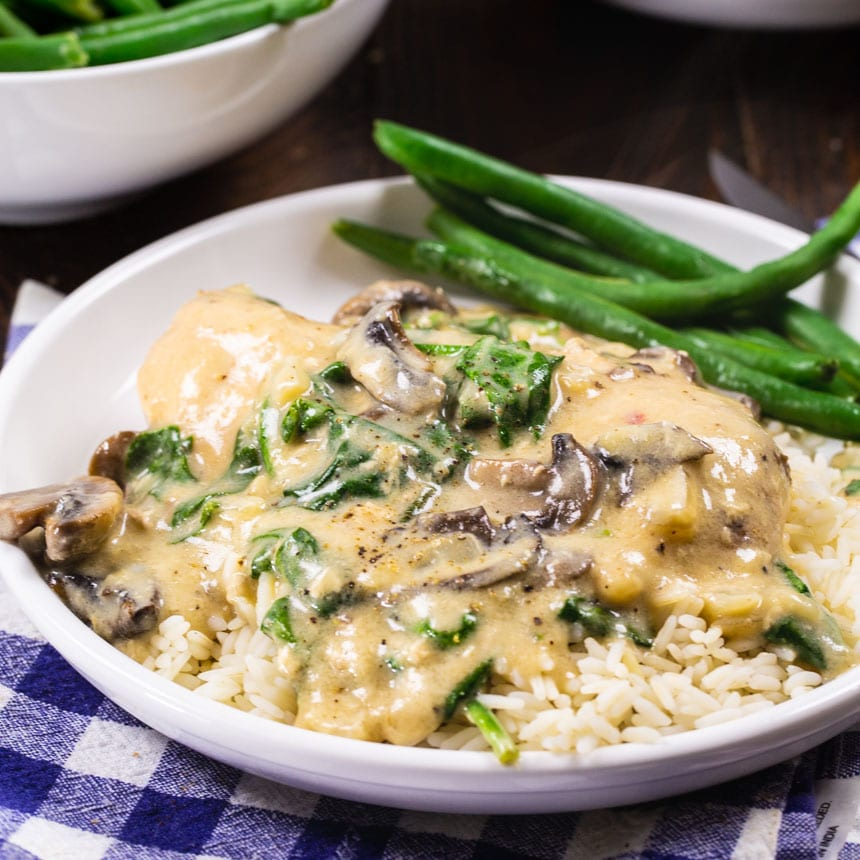 Parmesan Chicken over rice on a plate.