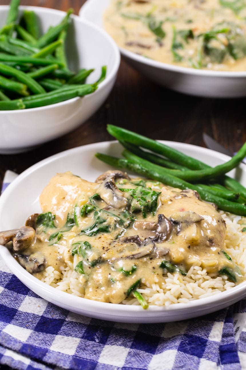 Slow Cooker Garlic Parmesan Chicken on plate with green beans.