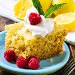 Slice of Slow Cooker Lemon Cake with fresh raspberries.
