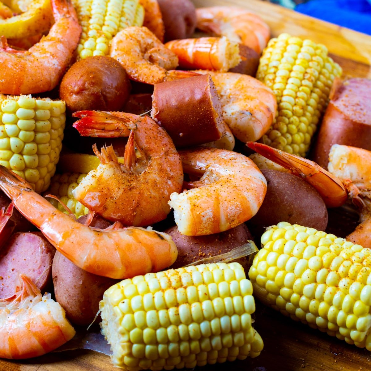 Slow Cooker Low Country Boil spread out on a table.