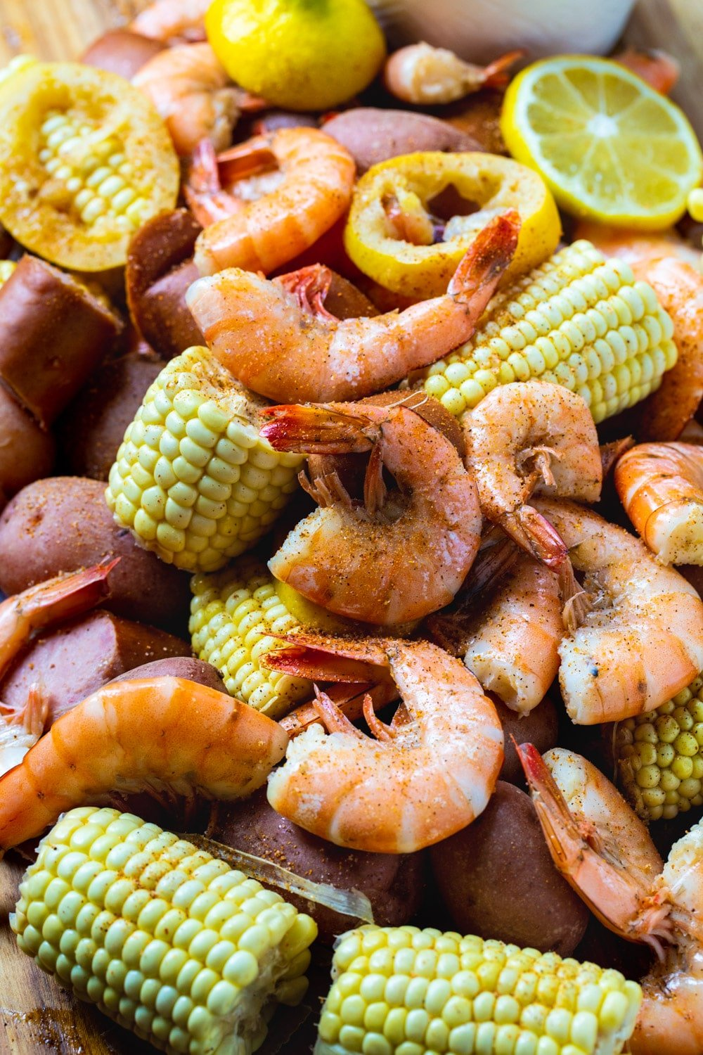 Close-up of Slow Cooker Low Country Boil spread out on a table.