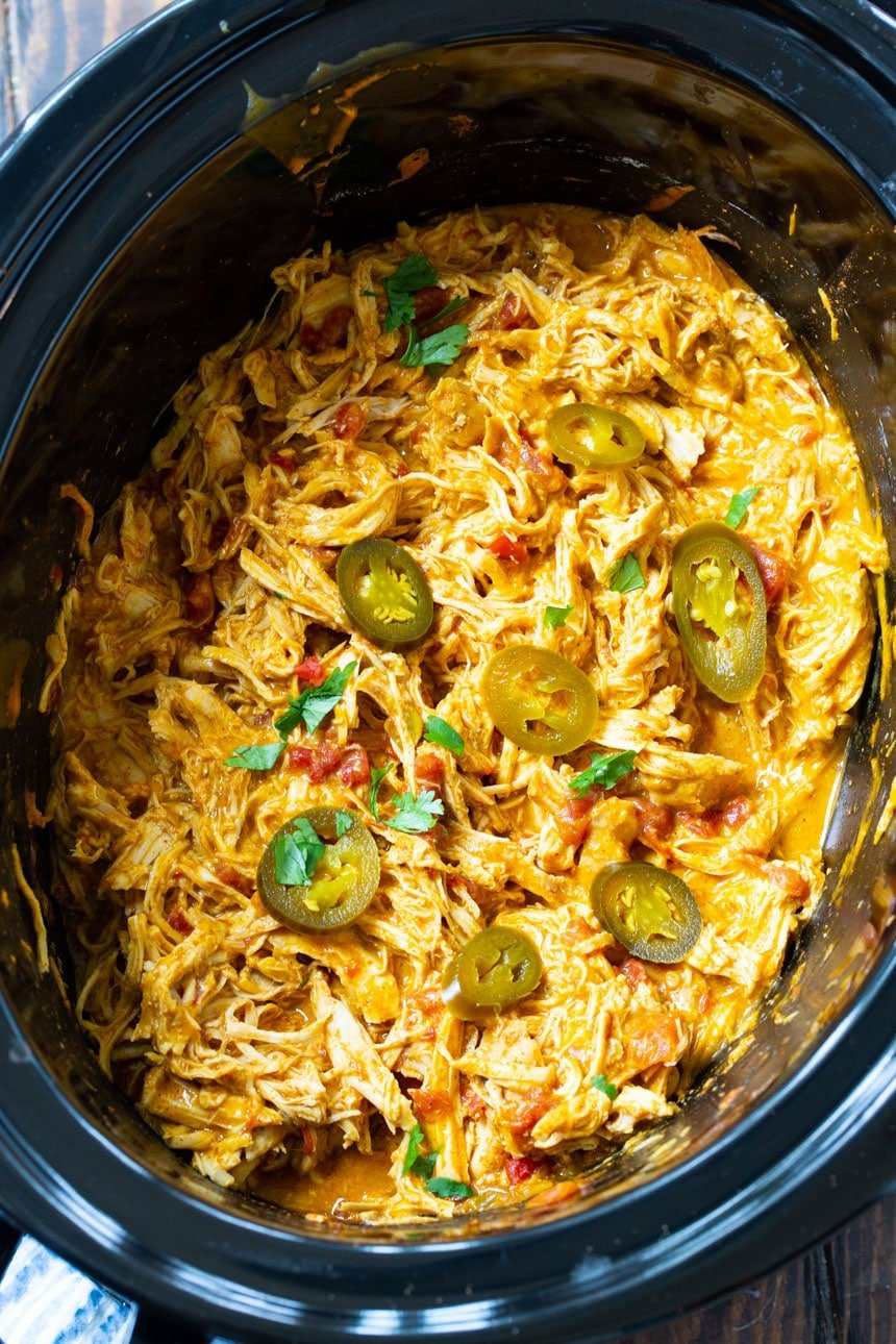 Shredded NAcho Chicken in a black 6-quart slow cooker