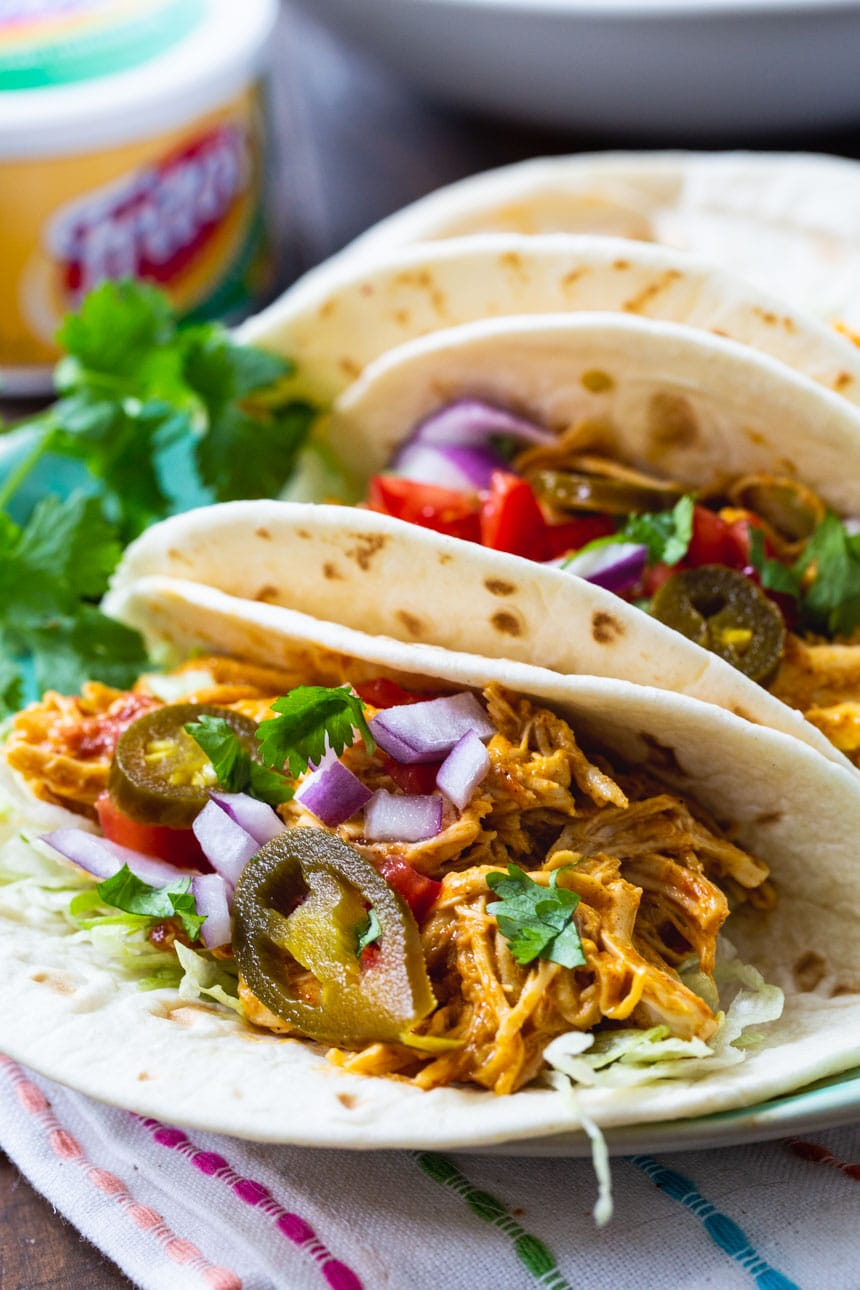 Shredded Nacho Chicken Tacos on a plate with cilantro.