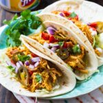 Three Nacho Choclen Tacos on a plate.