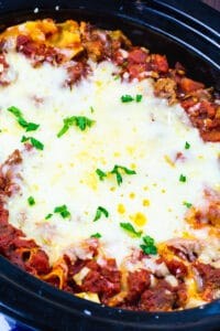 Sausage Lasagna in a black slow cooker.