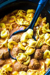 Slow Cooker Meatball and Tortellini Soup in a slow cooker.