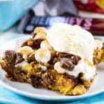 Piece of S'mores Bread Pudding topped with ice cream.