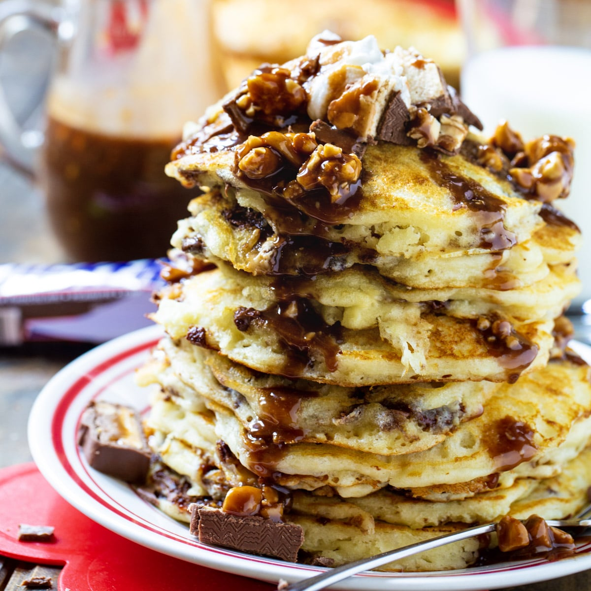 Stack of Snickers Pancakes on a plate.