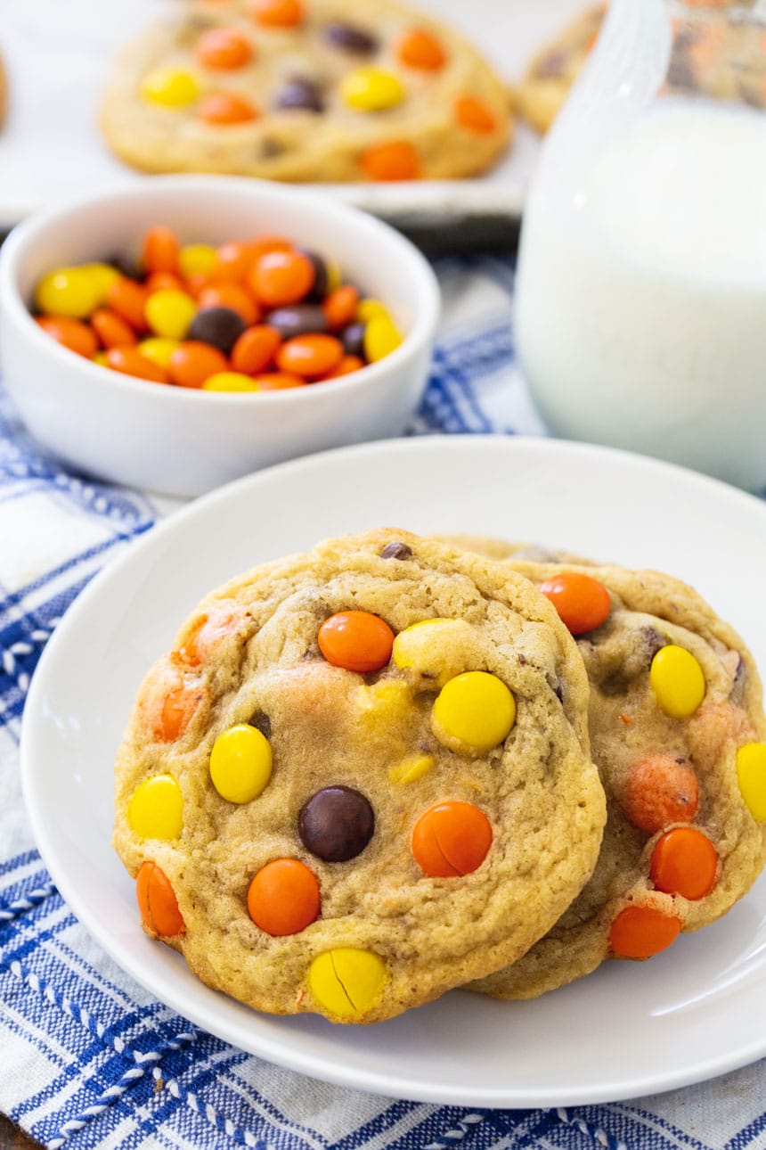 Soft Baked Reese's Pieces Cookies on a small white plate.