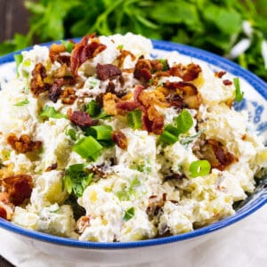 Sour Cream and Bacon Potato Salad in a blue and white bowl.
