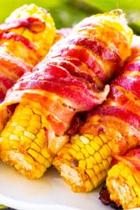 Spicy Bacon Wrapped Corn on a serving platter.