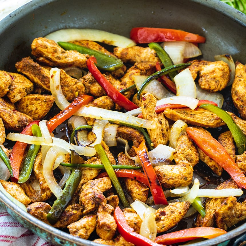 Chicken, bell peppers, and onion in large skillet.