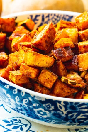 Bowl full of Spicy-Sweet Roasted Sweet Potatoes