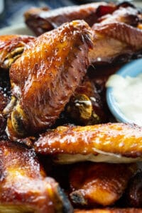 Sticky Soy Chicken Wings on a plate with dipping sauce.
