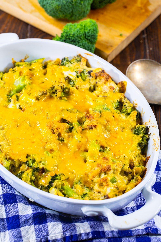 Broccoli Casserole with stuffing in a white casserole dish.