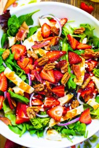Strawberry Fields Salad in a large white serving bowl.