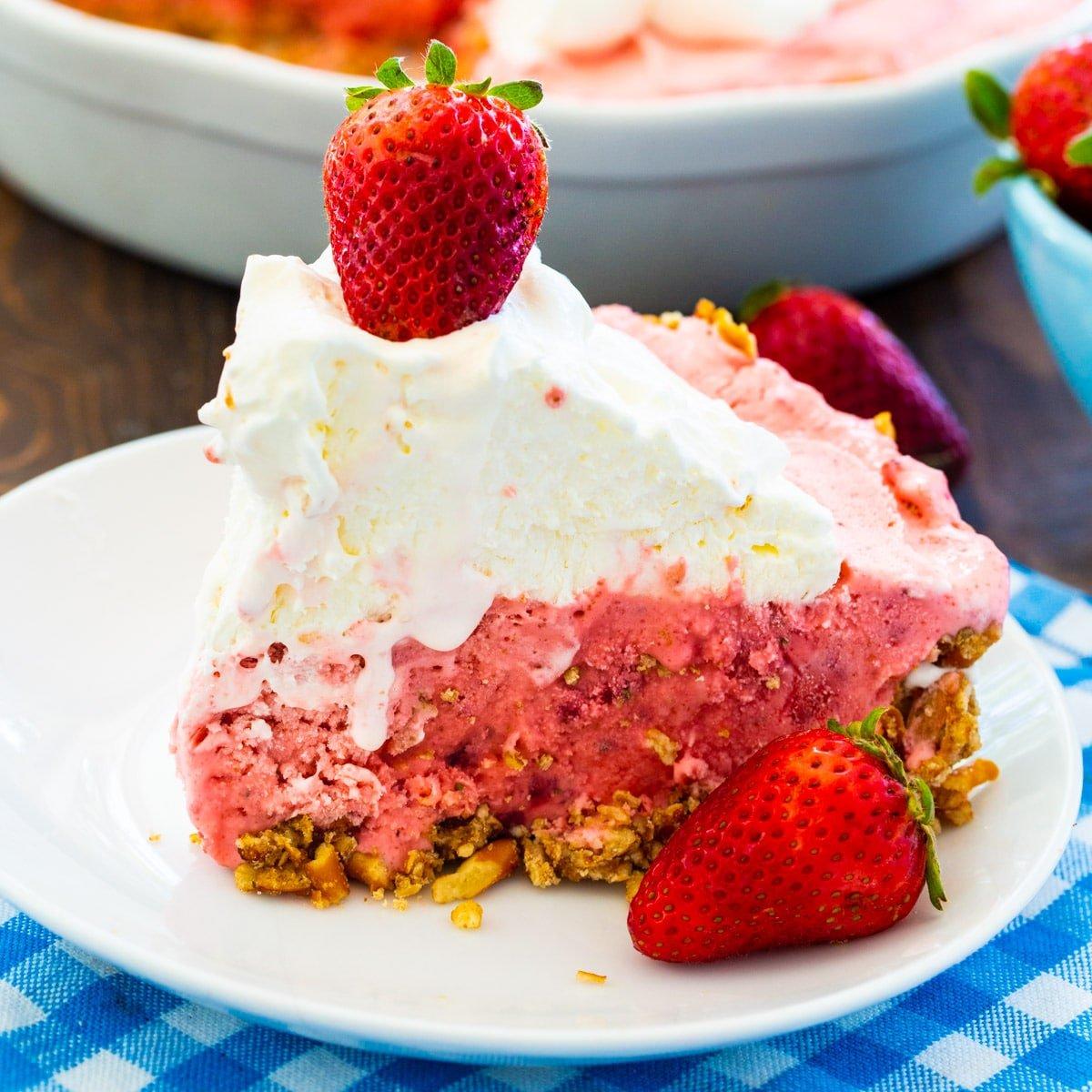 Slice of Strawberry Pretzel Icebox Pie on small white plate.