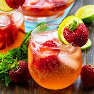 Strawberry Shortcake Sangria in a wine glass.