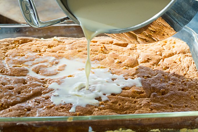 Pour the milk mixture over the tres leches cake